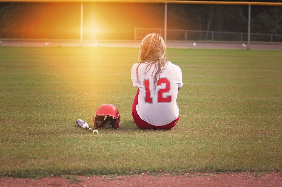 girl sitting in the field